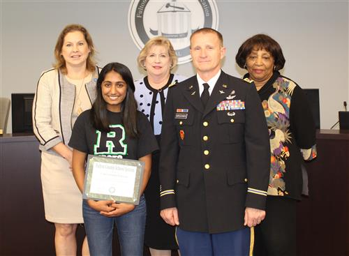 Roswell junior Anusha Pakkam and Lt. Col. Anthony Duplechien