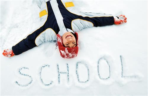 kid in snow with the word school in the snow