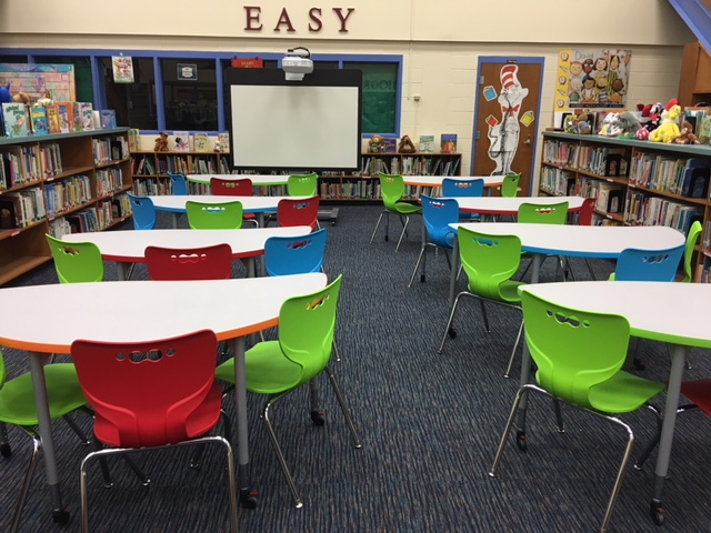Cooperative Learning Furniture with red, blue, green chairs in the Media Center.