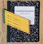 A black and white composition notebook with yellow pencils
